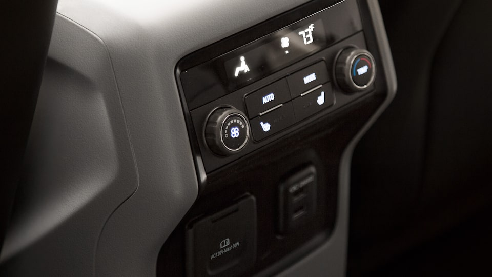 2019 Acadia mid-size SUV interior: rear-seat convenience features.