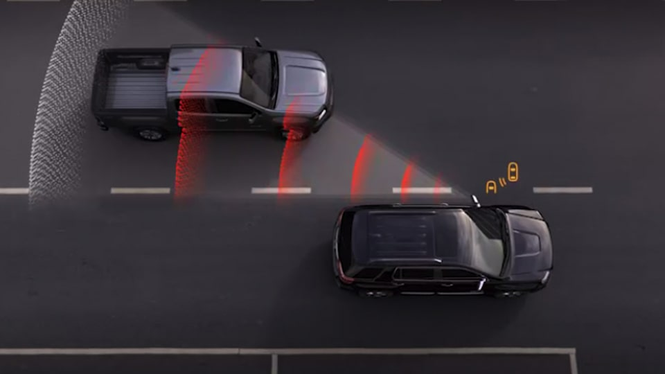 GMC Acadia's available Lane Change Alert and Side Blind Zone Alert features.