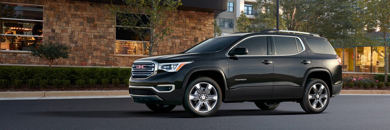 Exterior side profile of the GMC Acadia SUV.