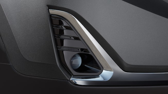Gloss-black accents detail the Terrain Denali's fog lamps.