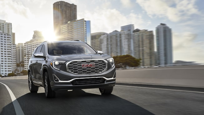 2019 GMC Terrain Denali small luxury SUV exterior: shown in Graphite Grey Metallic.