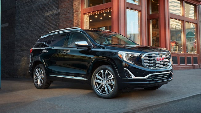 Exterior of the 2019 Terrain Denali shown in Ebony Twilight Metallic.