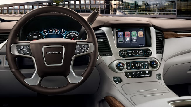 Yukon Denali's cockpit with Cocoa and Shale interior.