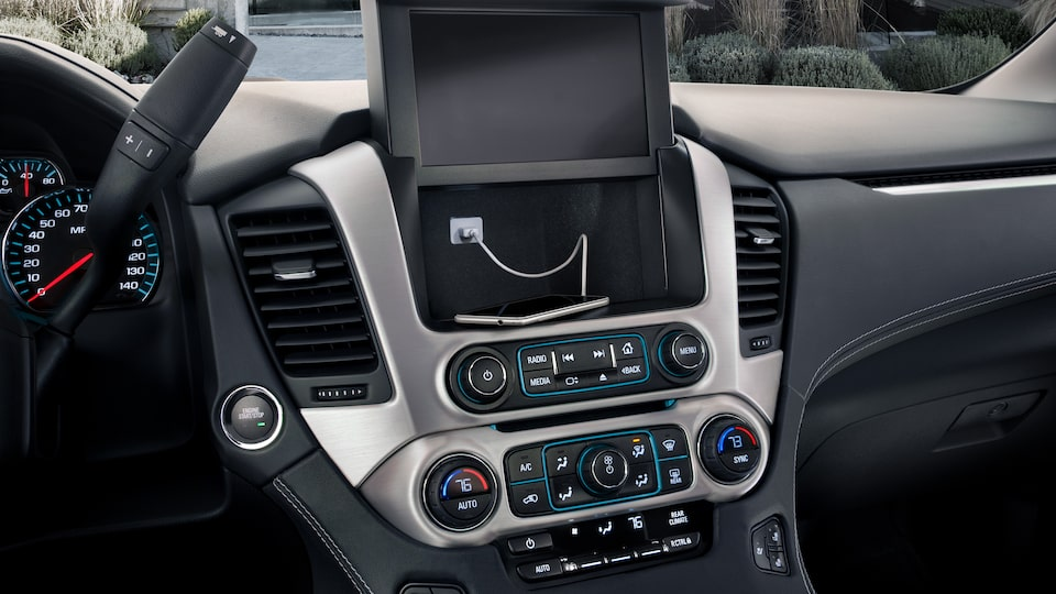 The behind screen storage of the 2019 Yukon, including USB connection.