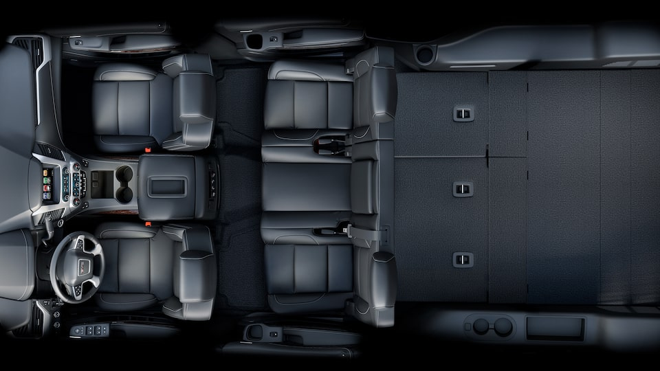 Interior view showing the flat third-row seats of the 2019 GMC Yukon.