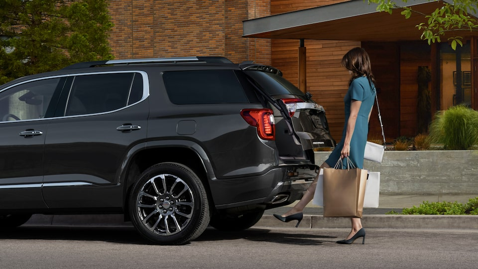 2020 GMC Acadia AT4 Mid-Size SUV: A Woman Using Her Foot To Activate A Motion Activated Liftgate.
