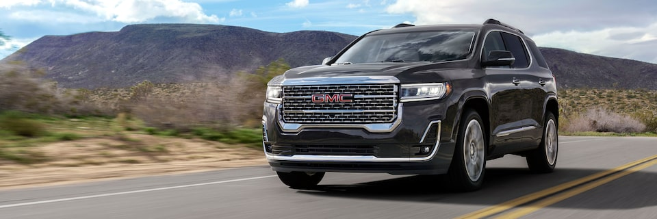 2020 GMC Acadia Denali: Front View With Mountain Background.