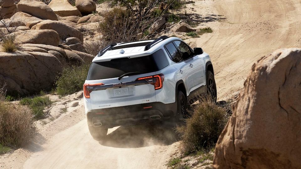 2020 GMC Acadia AT4 Mid-Size SUV: Driving On A Rocky Terrain Uphill.