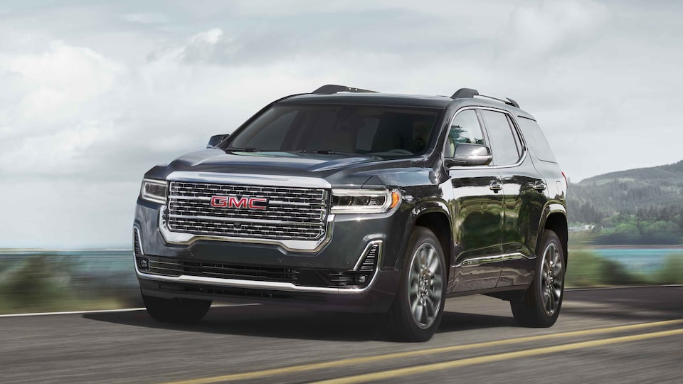 2021 GMC Acadia Denali parked on a hill.