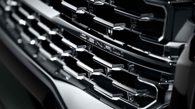 Close-up view of the 2021 GMC Acadia Denali Grille.