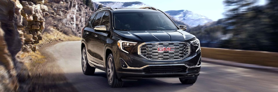 2021 GMC Terrain driving on the road.