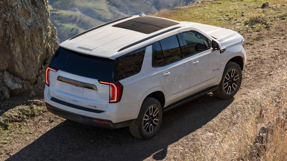 2021 GMC Yukon driving off-road.