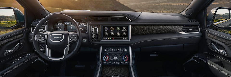 2021 Yukon interior front dashboard in jet black.