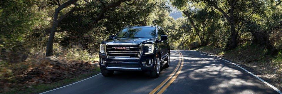 2021 GMC Yukon driving on the road.