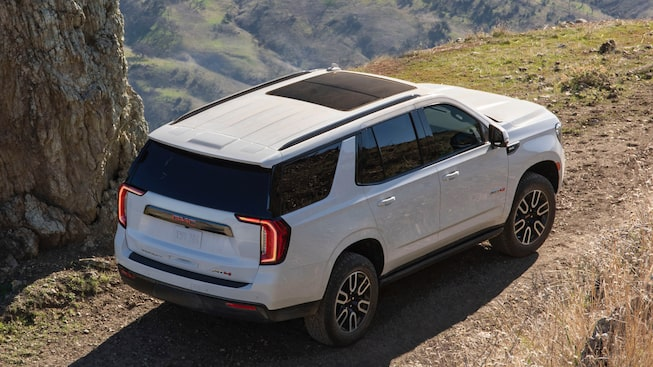 2021 GMC Yukon AT4 rear angle view.