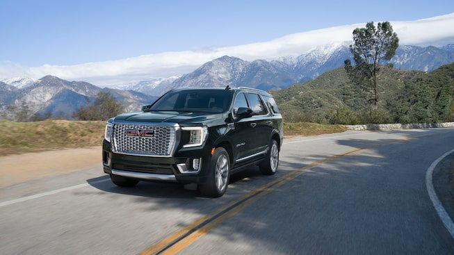 2021 Yukon Denali driving on the road.