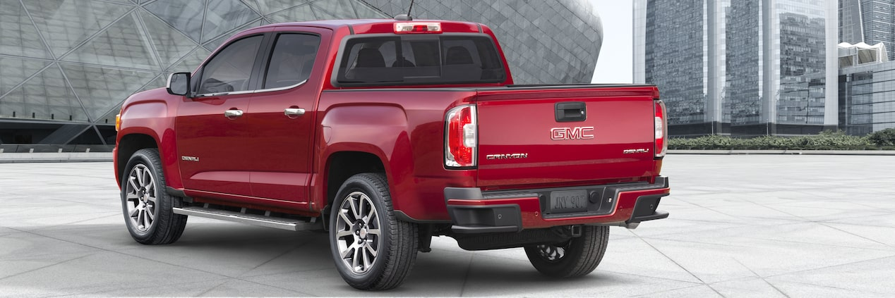 Exterior of the 2019 Canyon Denali mid-size pickup truck in Red Quartz Tintcoat.