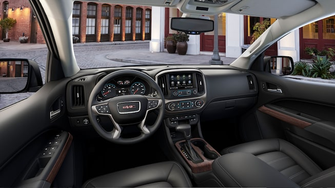 GMC Canyon Denali mid-size pickup truck's spacious cabin, seats 5 passengers comfortably.
