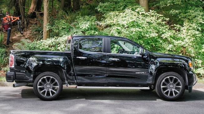 Side exterior view of the GMC Canyon Denali in Onyx Black.
