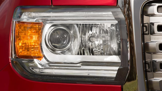 2019 GMC Canyon Denali's projector-beam headlamps with LED signature lighting.