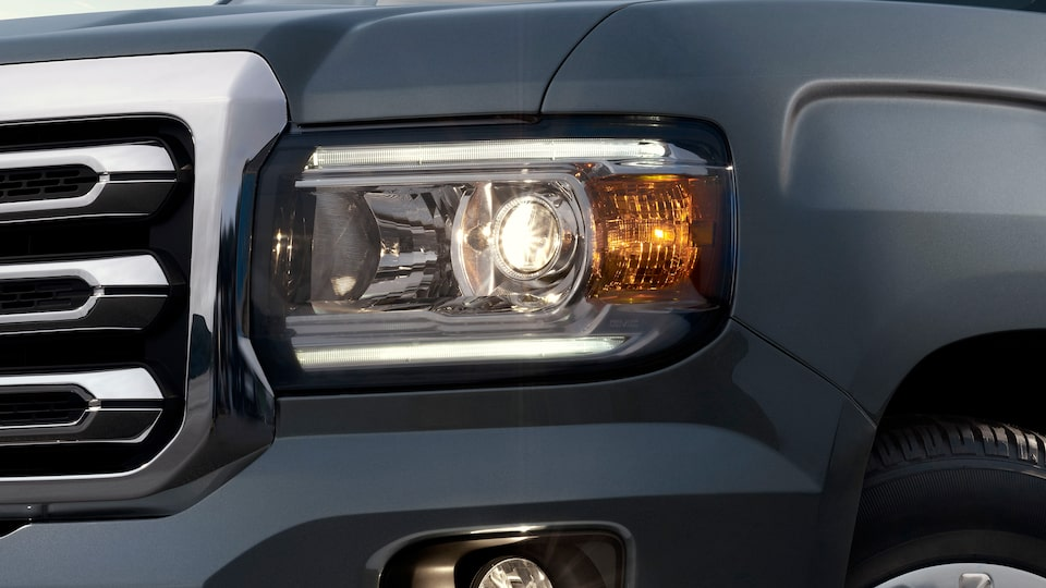 The 2019 Canyon's GMC Signature LED lighting and available High Performance LED headlamps.