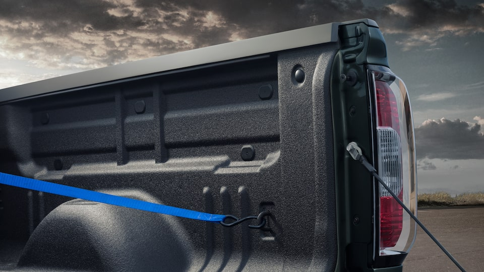 The 2019 GMC Canyon helps you secure cargo with four available upper tie-downs.