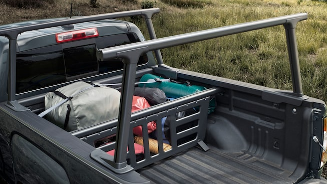 GMC Canyon's available cargo utility rack, bed divider and tiered storage cross rails.