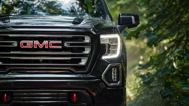 2019 Sierra AT4 exterior: LED headlamps with signature C-shaped LED lighting.