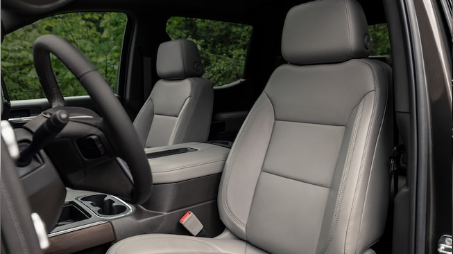 Interior of the 2019 GMC Sierra 1500 with available Dark Walnut/Slate perforated leather-appointed seating.
