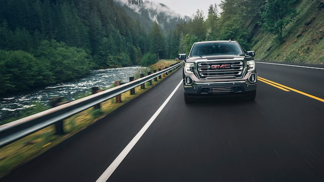 2019 Sierra's larger grille and available high-intensity LED headlamps.