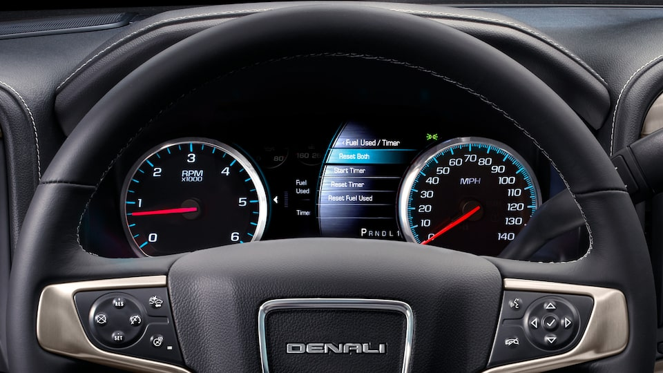 Sierra Denali HD pickup truck's soft-touch instrument panel with burnished aluminum trim.