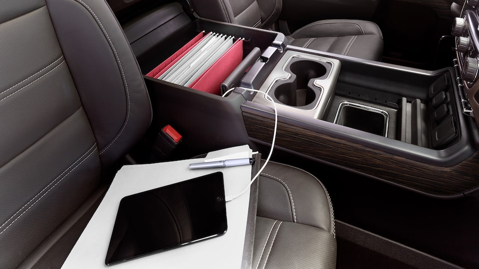 2019 Sierra Denali HD's available large centre console with 110V power outlet.