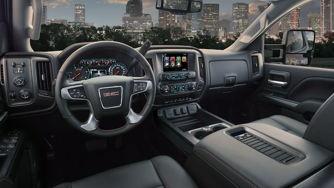 Interior of the GMC Sierra HD with available durable soft-touch instrument panel with aluminum trim.