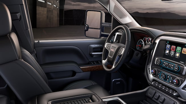 2019 GMC Sierra HD available heated and ventilated perforated leather-appointed front bucket seats.