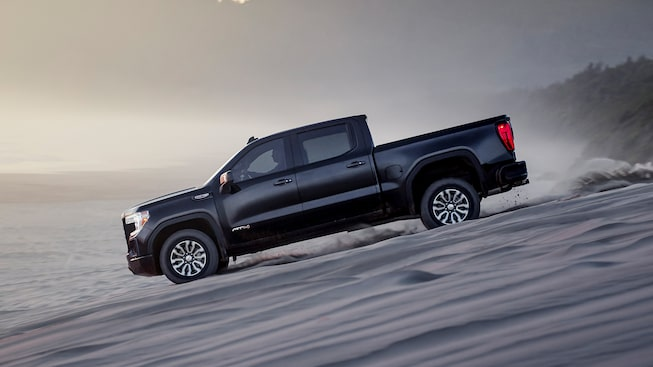 2020 Sierra AT4 Off Road Truck: Driving Down A Hill.