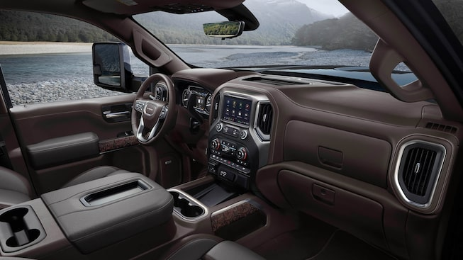 The 2020 GMC Sierra Denali HD pickup truck's interior with premium leather-appointed seating and open-pore ash wood trim.