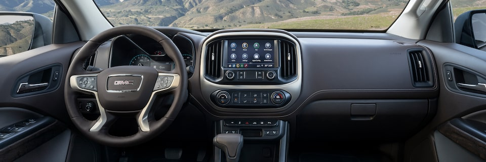 2021 Canyon interior dashboard featuring the steering wheel, infotainment system, and glove compartment.