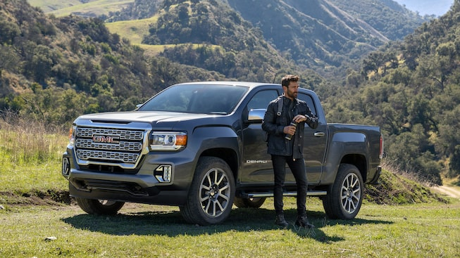 2021 GMC Canyon Denali parked in nature with a scenic view.