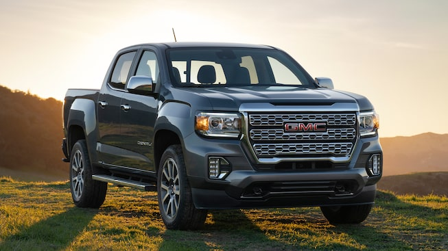 2021 GMC Canyon Denali with a scenic sunset.