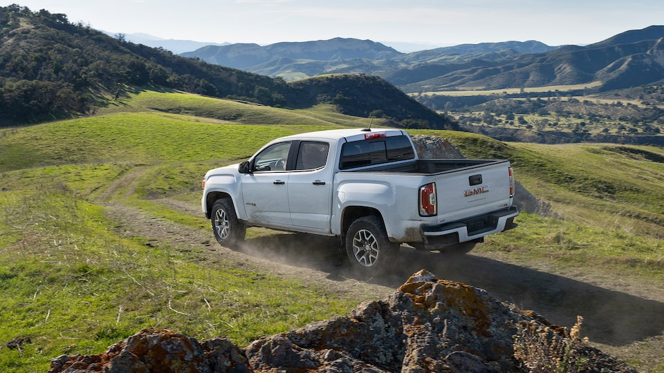 2021 GMC Canyon descending with a scenic view.