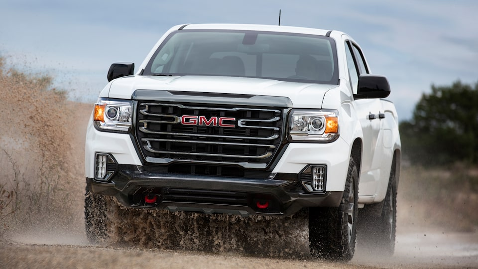 2021 GMC Canyon AT4 driving on the road.