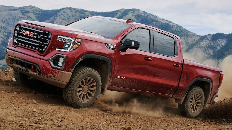 2021 GMC Sierra 1500 AT4 going up a terrain.