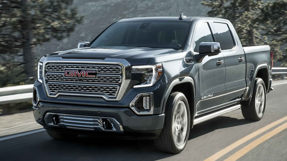2021 GMC Sierra 1500 Denali driving on the road.