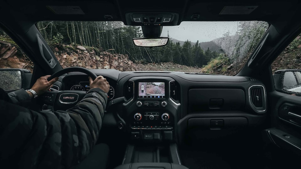 2021 Sierra 1500 driving on the road.