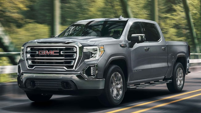 2021 GMC Sierra 1500 driving on the road.
