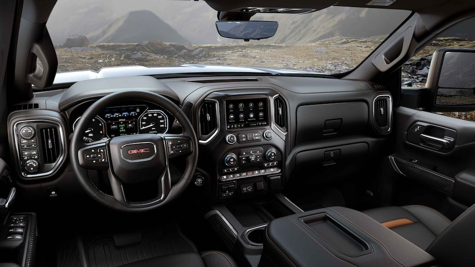 2021 Sierra HD AT4 athletic interior dashboard featuring the steering wheel.