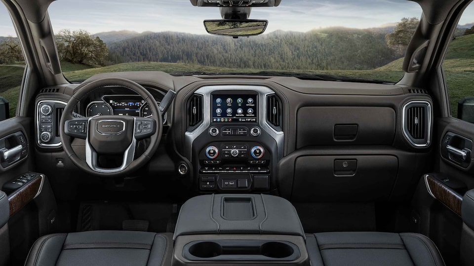 2021 Sierra HD Denali premium interior dashboard featuring the steering wheel and infotainment system.