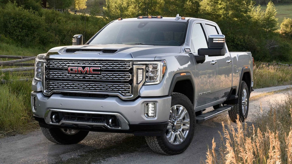 2021 GMC Sierra HD driving on the road.