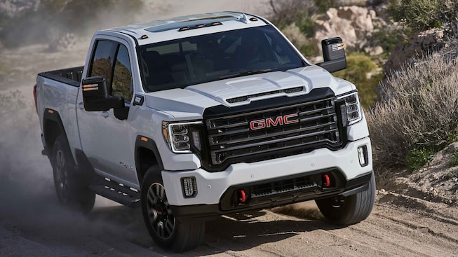 2021 GMC Sierra HD AT4 driving off-road.