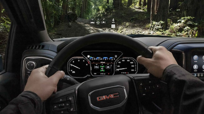 Man drives the 2021 Sierra AT4 off-road.
